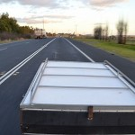 Motorcycle Camper Trailer being towed on the New England Highway